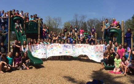 Waupaca Middle School sixth-grade students gather at Waupaca's South Park to show the banner they created for a health class project.  Submitted Photo